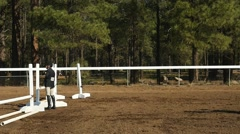 A Dressage horseback rider jumping Stock Footage