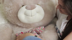 Girl with a soft toy Stock Footage