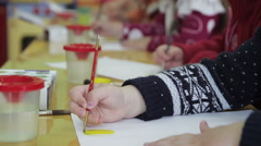 Children draw in kindergarten on paper Stock Footage