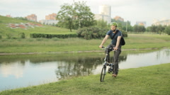 Man on folding bicycle with smartphone Stock Footage