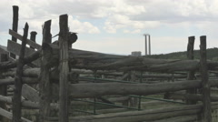Coal fired power plant twin smoke stacks weathered corral Stock Footage