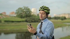 Businessman with helmet and smartphone Stock Footage