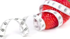 Strawberry with measure tape - stock footage