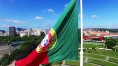 Portuguese Waving Flag in Eduardo VII Park in Lisbon, Portugal aerial view Stock Footage