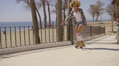 Woman Riding On Vintage Roller Skates. Stock Footage