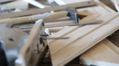 Fretsaw, hammer, knife and tongue and groove boards on working place - stock footage