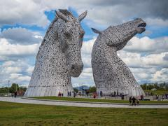 The Kelpies at Helix Park, head up and head down, Halkirk, Scorland, Uk - stock photo