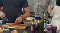 Mid-section of man chopping carrot in kitchen Stock Footage