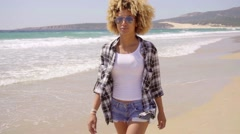 Afro-American Woman Walks Beach Along - stock footage