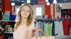 Portrait of satisfied women customers with shopping bags. Smiling - stock footage