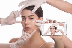 Examining face concept Stock Photos