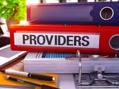 Providers on Red Ring Binder. Blurred, Toned Image - stock illustration