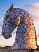 The Kelpies at Helix Park in early evening light, Falkirk, Scotland, UK - stock photo