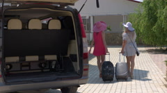 Hotel van shuttle service tourists arrived at summer resort walking with luggage Stock Footage