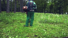 Man With a Lawn Mower in His Hand Stock Footage