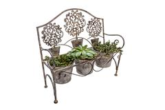 High Side View of  Ornate Rusted Wrought  Iron Bench Stock Photos
