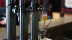 Beer Taps And Man With Beer In Background Stock Footage