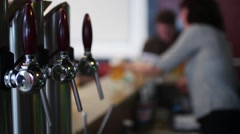 Bartender Woman Serving Draft Beer To Client - stock footage