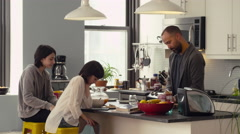 Father serving breakfast to his daughters in kitchen - stock footage