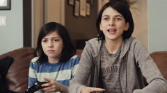 Girls playing video game in living room - stock footage