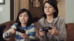 Girls playing video game in living room Stock Footage