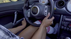 Close up on woman knees while driving a car Stock Footage