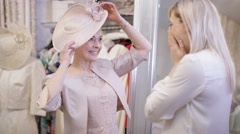 4K Bride to be shopping for an outfit with her mother in bridal wear store. Stock Footage