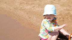 Toddler playing with sand toys on the beach. Stock Footage