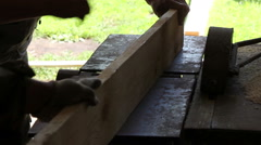 Two poor carpenter handle wooden Board on an old machine - stock footage