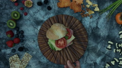 4k food composition on a vintage background with burger Stock Footage