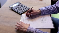 Engineer Designer Makes Calculations on a Calculator Stock Footage