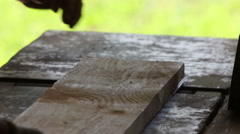Two carpenters planed board on the old machine Stock Footage