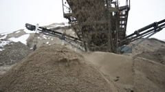 Conveyor belt dumping clean screened sand for building. A mountain of sand. Stock Footage