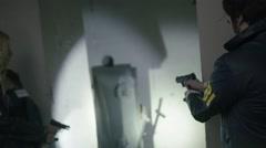 FBI Agents searching a dark bunker – Shot06/07 Stock Footage