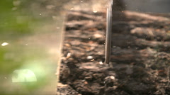 Cutting through wood with chainsaw in slow motion. - stock footage