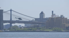 New York helicopter taking off in front of a bridge Stock Footage