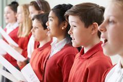 Group Of Children Singing In School Choir - stock photo