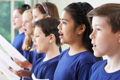 Group Of School Children Singing In Choir Together - stock photo