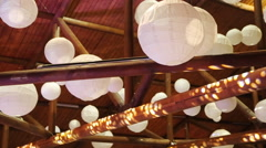 Many lanterns hanging under wooden ceiling Stock Footage