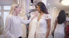 4K Bride to be shopping for her wedding gown with her best friend Stock Footage
