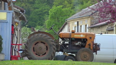 Old tractor engine tun on in french small village, sunny summer day + audio Stock Footage