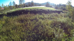 Drone shot of a golf course in the mountains Stock Footage