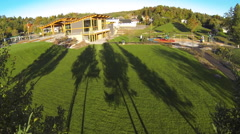 Drone shot of a town building next to a park Stock Footage