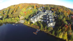Drone shot of a resort in the mountain during fall Stock Footage