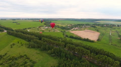 Hot air balloons in the sky over a field.Aerial view - stock footage
