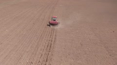 Aerial of tractor on harvest field Stock Footage