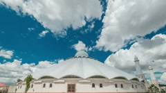 White clouds on a white Arab mosque. Kazakhstan - 4K Timelapse - stock footage