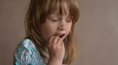 Close up of a girl eating crisps Stock Footage