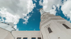 Bottom view of the tower white mosque and blue sky with clouds. Kazakhstan - 4K - stock footage