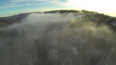 Drone shot of a town covered in fog Stock Footage